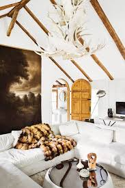 most beautiful white antler chandeliers for rustic interior with white sofa sets white wall paint catheral