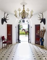 at designer ralph laurens residence in bedford new york a 19thcentury dutch chandelier presides over the