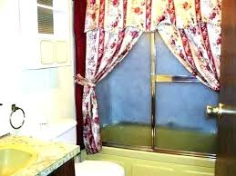 shower curtain or glass door stunning contemporary bathroom with bathtub doors curtains on tub hang in