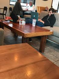 this guy at the coffee took his shoes off and put his feet on the coffee table