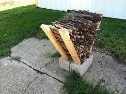 a v shaped wood rack ilized with cinderblocks