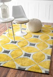 rectangle yellow and grey rug in leaves accent under white acrylic chair with round pedestal area