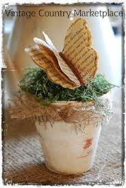 book pages erfly tucked inside burlap painted flower pot i think i can figure