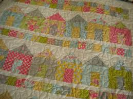 House Quilt Patterns: 5 Homey Designs to Try & Colorfully-Patterned Quilted Rows of Houses Adamdwight.com