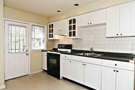 white cabinets black countertops what color walls