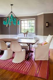 turquoise glass chandelier + panton chairs + farm table in eclectic dining  space by Design Manifest