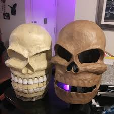 Twin paper mache skull masks - ready to begin the second skull