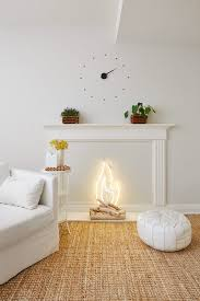 in keeping with the idea of a cloud the two went with a palette of all white wall colors upholstery furnishings shelving and even desk accessories