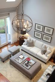 high ceilings and stylish design this living room uses a beautiful palette of soft gray