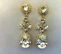 astounding gold tone crystal chandelier earrings