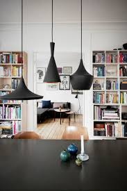 TOM DIXON BRASS PENDANT LIGHTS IN A DANISH HOME