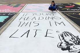 high school seniors paint their parking spots and what they come up with is brilliant