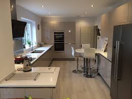 This galley kitchen incorporates a breakfast bar area to create a fantastic  social area. With
