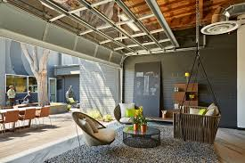 outdoor office space. One Workplace - Outdoor Office With Open Garage Breakout Area Space