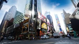 people walking on sidewalks along skysers in new york city ap images