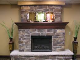 stone fireplace with wooden mantel shelf