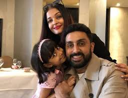 aishwarya rai daughter aaradhya join abhishek bachchan for a holiday pose for a family