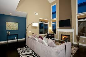 high ceiling room decoration. living room design with blue wall fireplace and high ceilings ceiling decoration