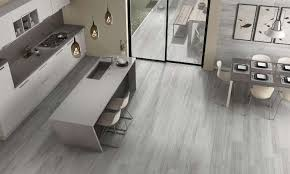 a new wood effect porcelain tile collection featuring a delicate design inspired by classic oak wood with a subtle shade variation that adds an overall