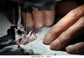 Quilting Hands Stock Photos & Quilting Hands Stock Images - Alamy & womans hands working sewing machine - Stock Image Adamdwight.com