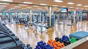 a area including free weights rowing machines and other quality gym equipment in le