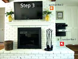mounting a tv over a fireplace into brick mounted above fireplace hiding wires best image mounting