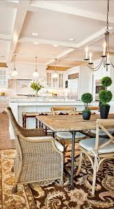 family home with fabulous white kitchen home bunch an interior design luxury homes blog i cant tell if the chandelier and island lights have casual dining room lighting