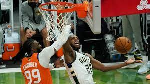 Middleton sends Bucks past Suns to tie ...
