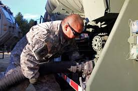 u s department of defense photo essay army sgt michael aguilar connects a fueling hose on a truck at eel river conservation