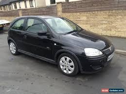 clic 2005 vauxhall corsa sxi black 56018 miles 1 2 petrol 3 door hatchback
