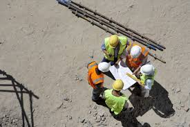 finding a job in b c s hottest sectors news talk 980 cknw elevated view of five builders standing in a circle looking at plans