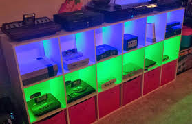 game room lighting ideas. video game console shelves with colored lighting via reddit user bishsticks room ideas e