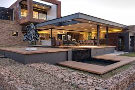 retaining wall design for home exterior in modern house completed with glass wall design ideas and