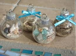 Make your own stunning nautical beach inspired Christmas ornaments by  filling glass ornament balls with sand