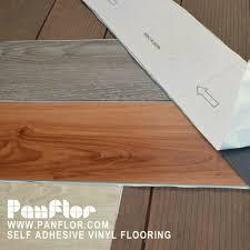 vinyl flooring adhesive home design ideas and pictures self adhesive vinyl floor tiles black