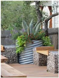 Small Picture Galvanized steel container garden with gravel paths and arbors