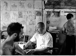 the magical tattoo artists of post magazine south tattooist chan tra blesses a sak yant on the arm of writer nathan thompson in phnom penh