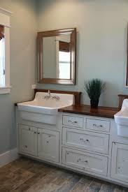 fancy farmhouse sink in bathroom with bathroom vanity with farmhouse sink
