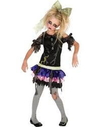 transform your cute little into a cute little zombie in this zombie doll child costume ripped and tattered dress and tights zombify even the most