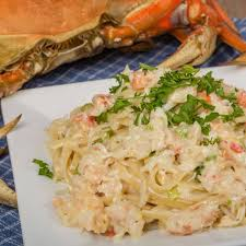 crab alfredo on white plate with king crab