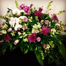 casket spray with orchids and roses garden design with white and purple orchids and roses in