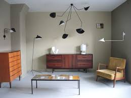 falling arm ceiling lamp by serge mouille for a chandelier as inspired as it is impressive this new design departs significantly from the
