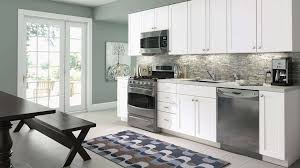 Winsome Top Kitchen Faucet Brands Within Decora Kitchen Cabinets