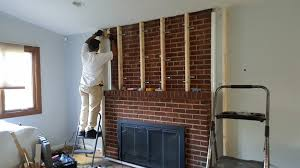 constructing a build out on a brick fireplace to mount a flat tv and conceal the wires
