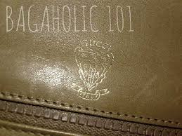 gold gucci knight printed in gold on the leather interior of an authentic vintage gucci accessory