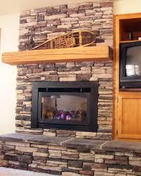 image of stacked stone tile fireplace surround