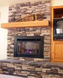 image of stacked stone tile fireplace surround