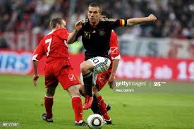 Lukas Podolski of Germany is challenged by Ivan Woods and Roderick... News  Photo - Getty Images