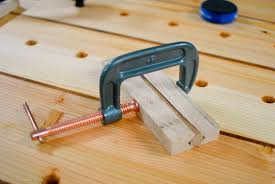 bench dog clamp. i clamped the dog in between two pieces of oak. bench clamp