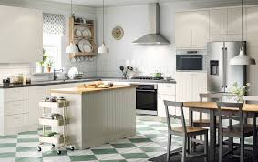 A large country kitchen with off-white drawers, doors and a kitchen island.